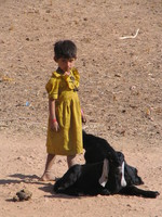 041213213422_yellow_girl_and_black_sheep