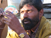 041204021540_concentrated_poker_player_at_ramnagar_bus_station
