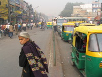 041129221054_old_lady_outside_main_bazar