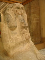 007_near_life_size_limestone_statue_of_a_seated_pharaoh