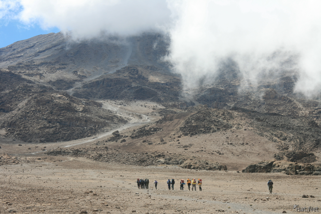 team of ascending hikers