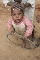 child and wheel Rawangi, East Africa, Tanzania, Africa