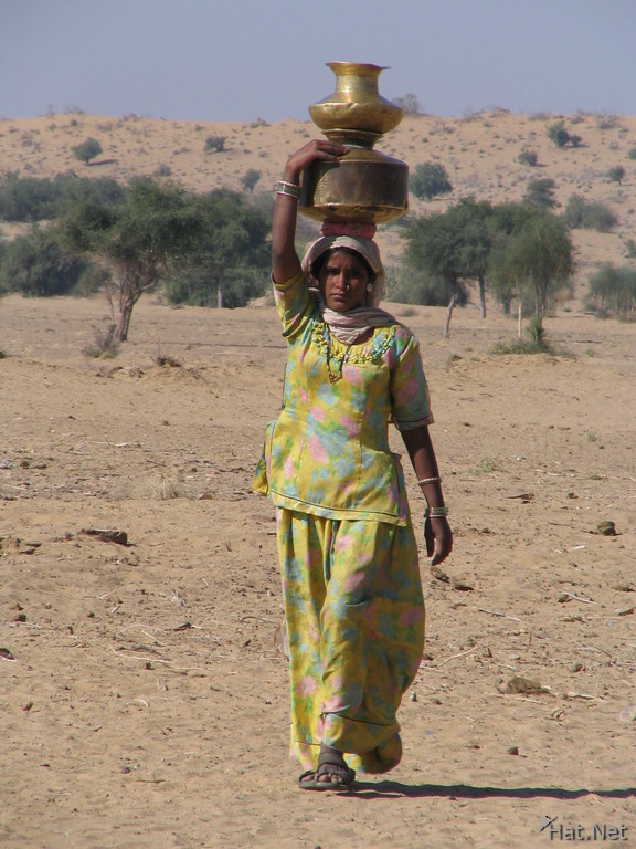 water lady in jaisalmer desert
