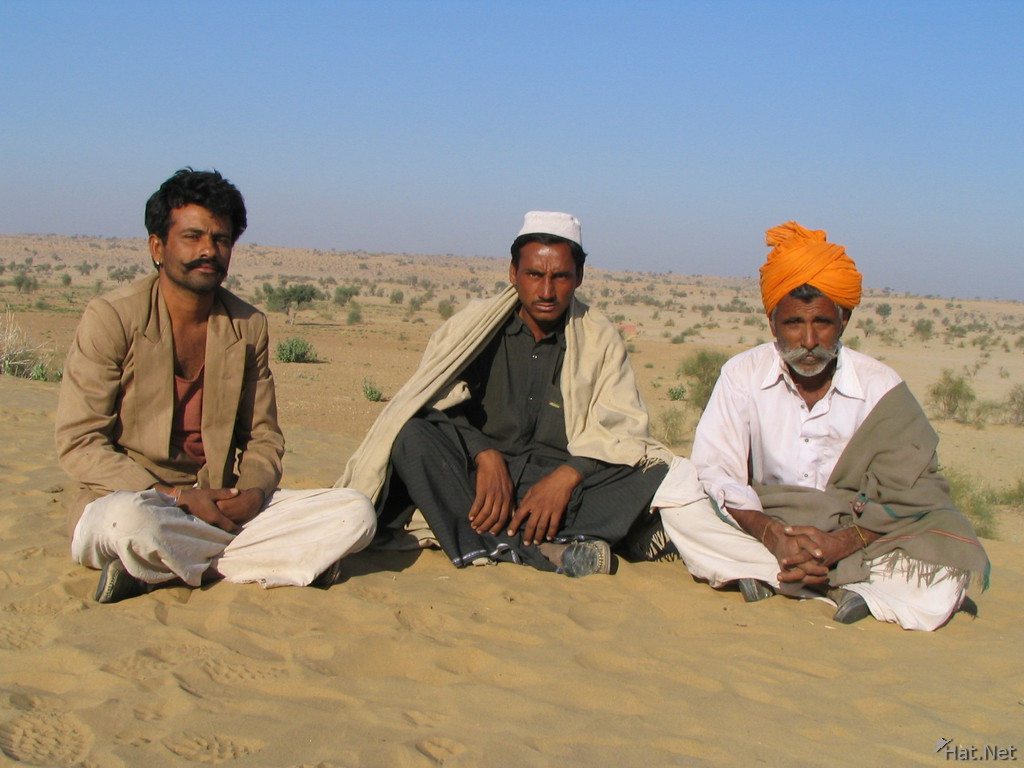 three men in desert