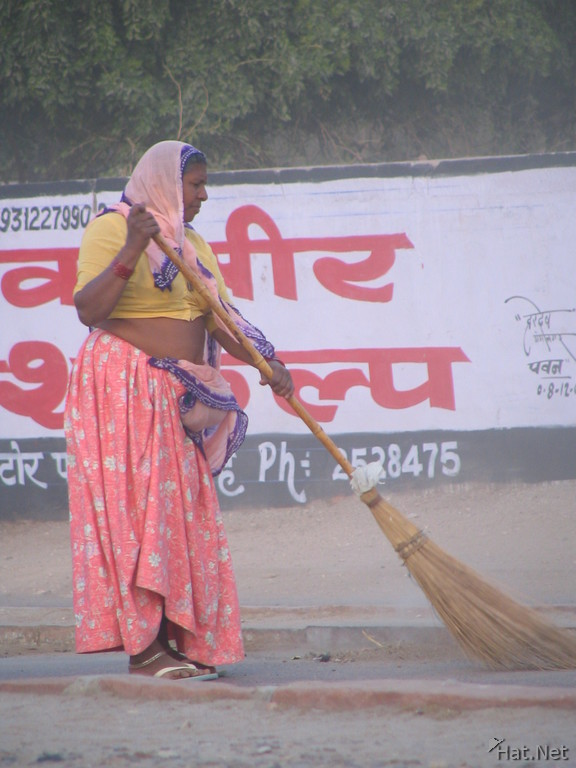 lady cleaning the street in bikaner