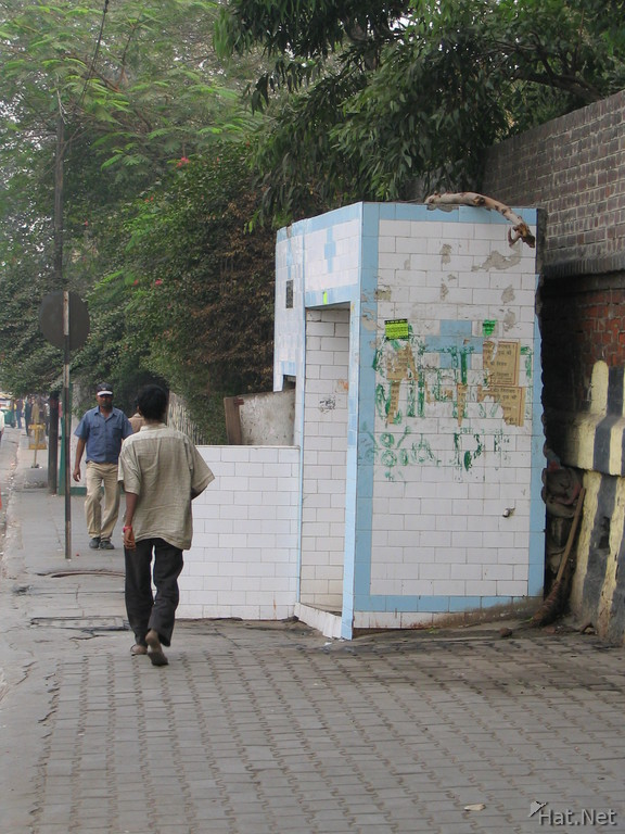 open toilet on a main street in old delhi