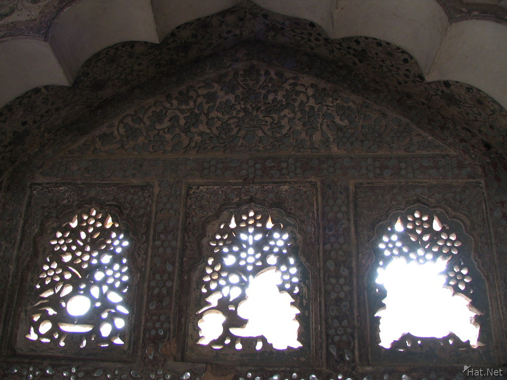 three carved windows