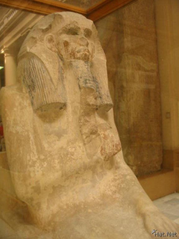 near life size limestone statue of a seated pharaoh