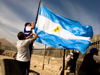 raising argentina flag Iruya, Jujuy and Salta Provinces, Argentina, South America