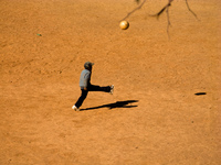 child playing football Purmamarca, Northern Salta Provinces, Argentina, South America